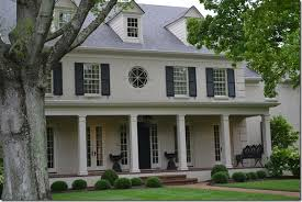 taupe painted brick with black shutters lantern curb appeal