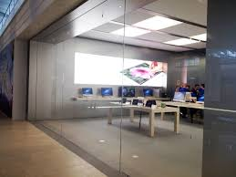 remarkable apple store design with cream wooden rectangle desk to