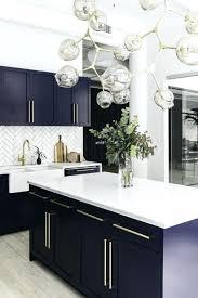 dark kitchen cabinets with light countertops antique white island