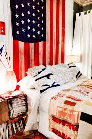 25 creative ways to decorate your dorm room diy budget friendly a flag hung on the wall is a great way to show your patriotic spirit