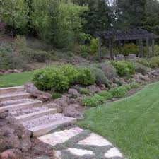 How To Landscape A Sloped Backyard - sloped front yard landscaping and gardening solution small home
