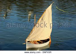 wooden model boat sailing on the ornamental lake of luxembourg