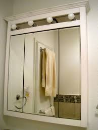 illuminated bathroom cabinet with shaver point tags mirror