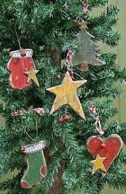 the 25 best primitive ornaments ideas on