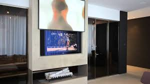 home decor automated painting lift to hide tv above fireplace by