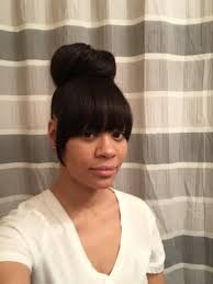 faux with bun extensions added for bangs and fuller bun