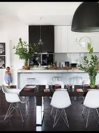 black and white kitchen with glass pendants over island bench and