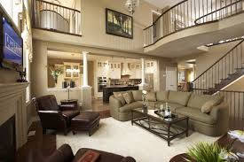 plush living room high ceiling design with huge chandelier also