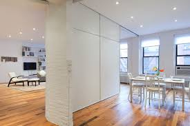 white accent temporary room divider design featuring laminate
