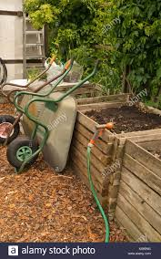 compost bin and wheelbarrow stock photos u0026 compost bin and