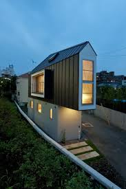 11 spectacular narrow houses and their ingenious design solutions river side house in horinouchi
