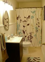 remodel bathroom on a budget white toilet on gray tile floor as