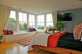 homes with big windows the master bedroom suite features large