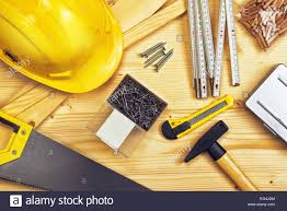 assorted woodwork and carpentry or construction tools on pine wood