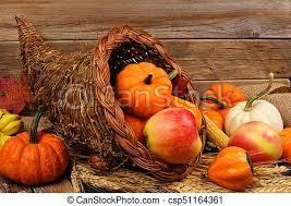 stock image of thanksgiving cornucopia against rustic wood