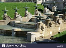 baroque ornamental fountains in the gardens or park of palais