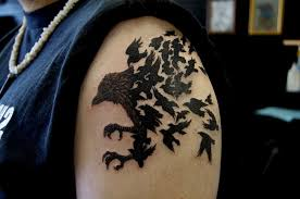 cool black bird tattoos on upper arm for men tattoo design ideas