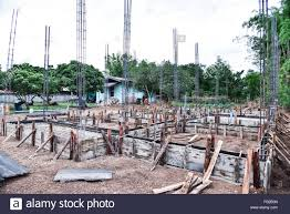 concrete footings for the foundation of a house under construction