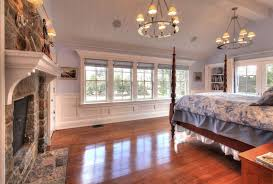 wainscoting bedroom ideas cottage master bedroom with wall sconce hardwood floors zillow
