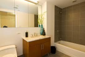 bathroom remodel budget breakdown white toilet on gray tile floor