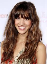 pictures relaxed long curly hairstyle with bangs