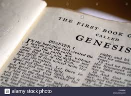 bible open at the first page of the book of genesis stock photo