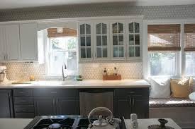 kitchen backsplash glass tile white beadboard cabinet doors