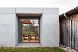 glass and concrete pavilion extends timber paneled home in leipzig