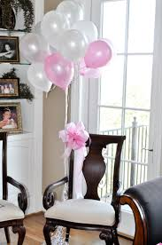 baby shower chair decorating with balloons when planning a baby shower