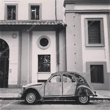 old citroen old citroen 2cv car parked near the house in the street black and