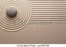 zen garden stone on raked sand mini rock garden stock image