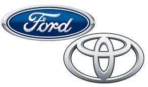 logo ford ford and toyota discussing collaboration on truck and suv hybrid