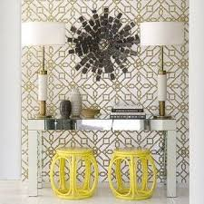 gold metallic peacock mirror with gray console table