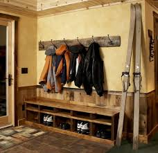 this simple rustic bench allows for seating and storage of boots