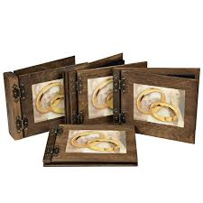 Photo Album Guest Book Two Large Wedding Rings On A Wooden Album And Guestbook As A Symbol O