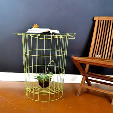 yellow steel nightstand with shelf and black top on ceramics