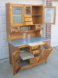 early oak hoosier style wilson bakers cabinet w glassware tilt