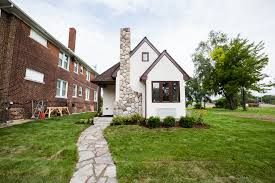 tiny house zoning regulations what you need know curbed white tiny house with brick chimney