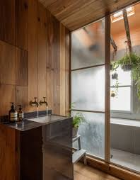 smoked oak and rustic clay line walls japanese styled apartment
