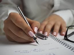 pens that write on black paper free stock photos of writing pexels woman in white long sleeved shirt holding a pen writing on a paper