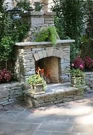 outdoor stone fireplace large outdoor fireplace with stone veneer by peter wodarz
