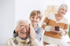 grandfather s boy covering his grandfather s eyes stock image image of love