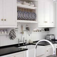 beadboard backsplash in kitchen kvanum kitchens white kitchen cabinets glossy black quartz