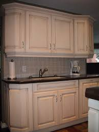 two different marble tile backsplash kitchen cupboard door