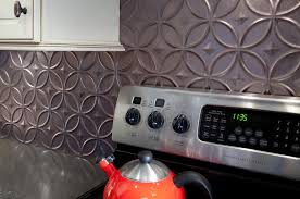 Kitchen Backsplash Ideas To Fit Any Budget - Metal kitchen backsplash