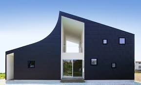 Modern Two Storey House With Streamline Roof by Funky And Modern Kht House Accommodates Two Families Under An