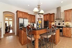 wrought iron kitchen island traditional kitchen with black granite countertops kitchen island