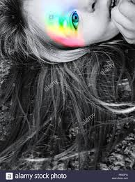 digital composite image of with rainbow color flash on face