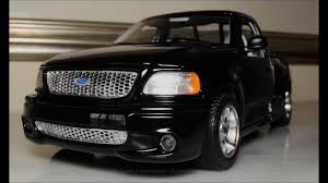 1 21 1999 ford f 150 svt lightning pickup truck black by bburago