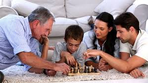 extended family chess at home on the living room floor